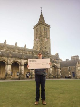 St Andrews Uni fundraiser holding cheque