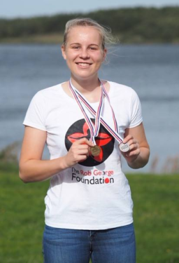 RGF Grantee Miriam showing medals