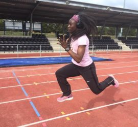 Leanza sprinting on running track