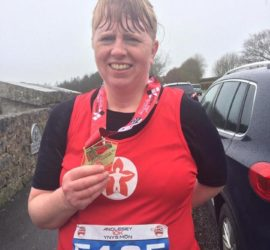 Rachel Driver with running medal