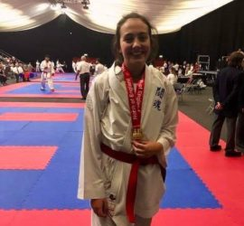 Rebecca wearing her two Karate medals