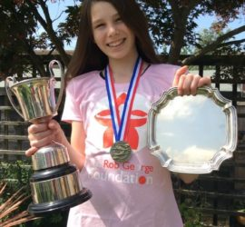 Heaven with her swimming trophies and medals
