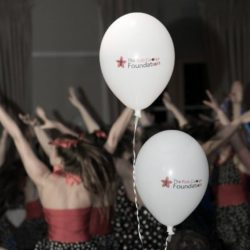 RGF balloons in a crowded room